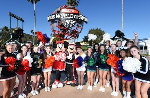 Cheerleaders competing in the Varsity National High School Cheerleading Championship pose with Mickey Mouse and Minnie Mouse at ESPN Wide World of Sports Complex at Walt Disney World Resort, which announced Friday it is building a new venue for cheerleading and dance team competitions. The building, which will be able to seat 8,000 guests, is expected to be complete mid 2017.