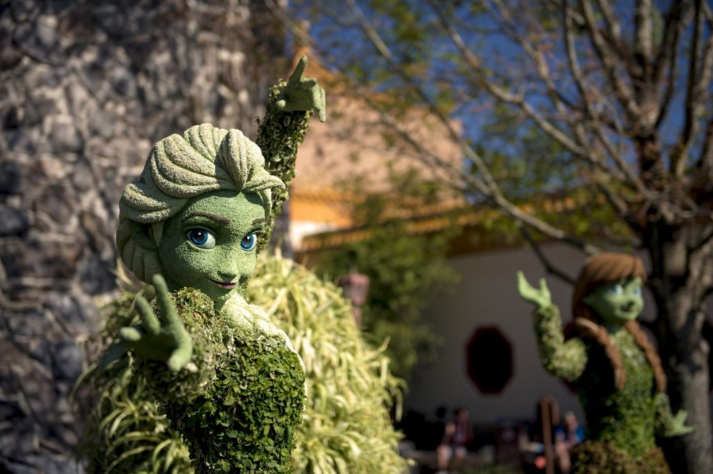 """Anna and Elsa appear in a topiary vignette straight from Disney's """"Frozen"""" for the Epcot International Flower & Garden Festival. The festival, which takes place each spring at Walt Disney World Resort in Lake Buena Vista, Fla., features dozens of character topiaries, garden- and backyard-living-inspired Outdoor Kitchen food and beverage tastes, stunning floral displays, gardening seminars and the Garden Rocks concert series. (Ryan Wendler, photographer)"""